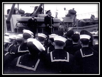 Post WWII- Rebuilding, goodwill and good borders.  Addressing the men.. Admiral on the USS Spokane (cruiser)