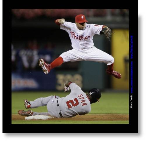 "Baseball Photo with accreditation to  www.commercialappeal.com ""Nationals' Denard Span after forcing him out at second base on a ball hit by Bryce Harper, who was safe at first"""