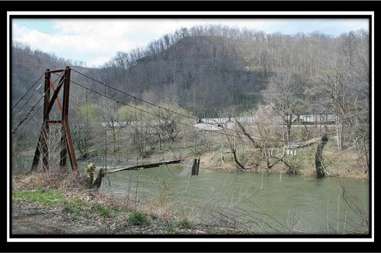 photo of dilapidated bridge.  Troubled Bridge Over Water (before being replaced with $1.3 million bridge)