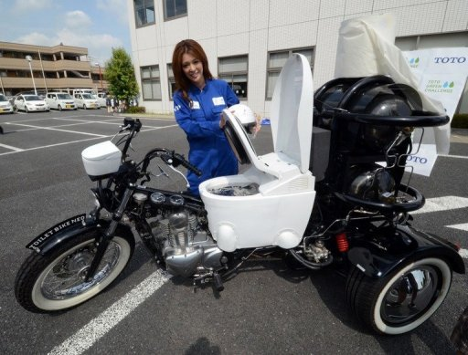 Photo of Toto  Neo (Japanese Toilet Mfg) unveils a biogas powered toilet motocycle